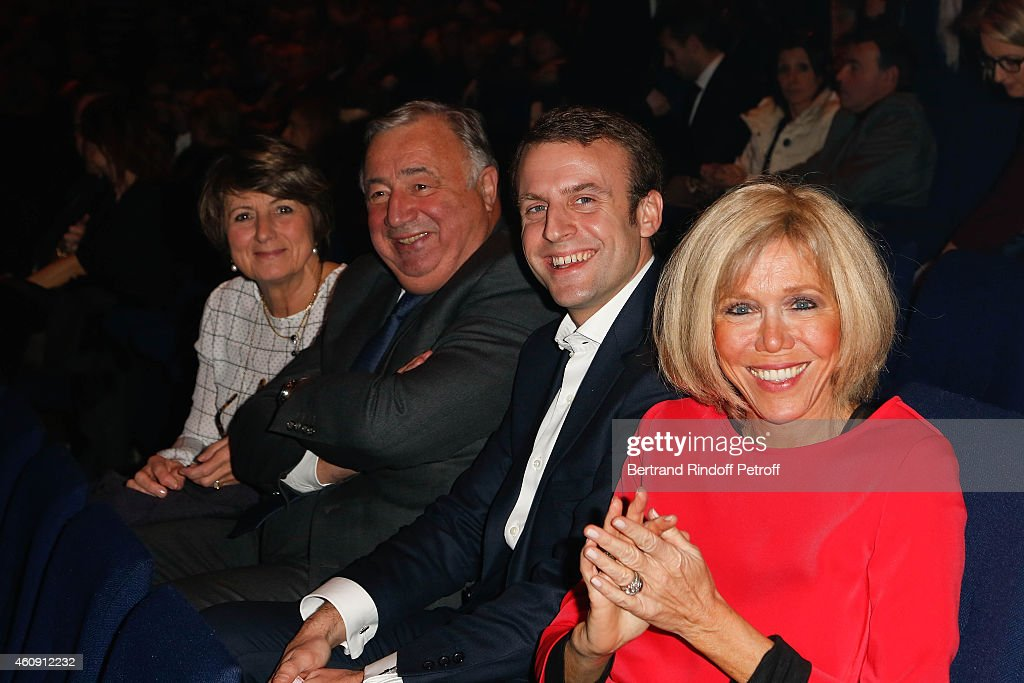 Senat President Gerard Larcher and his wife and Economy Minister <a gi-track='captionPersonalityLinkClicked' href=/galleries/search?phrase=Emmanuel+Macron&family=editorial&specificpeople=9899223 ng-click='$event.stopPropagation()'>Emmanuel Macron</a> and his wife Brigitte Trogneux attend the Laurent Gerra Show, at Palais des Sports on December 27, 2014 in Paris, France.