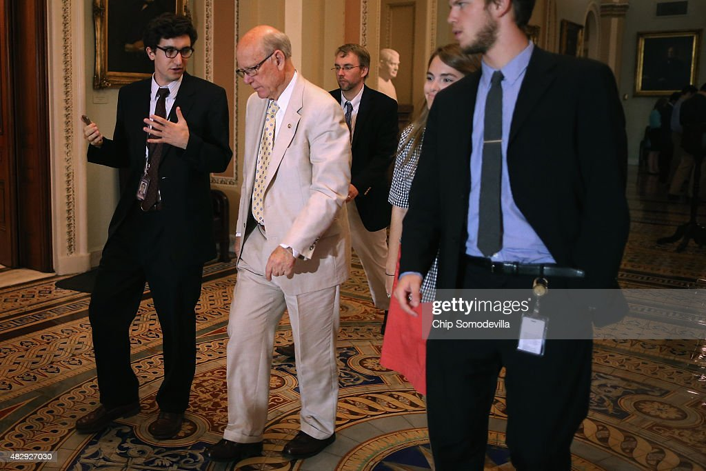 Senate Agriculture Committee Chairman Pat Roberts (R-KS) (2nd L) talks with a reporter after the weekly Senate Republican policy luncheon at the U.S. Capitol August 4, 2015 in Washington, DC. Senate Majority Leader Mitch McConnell and his leadership team said they will work to pass a cybersecurity bill before the end of the week when the Senate will break for four weeks.