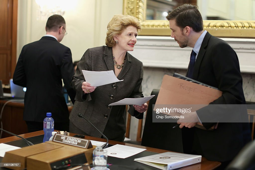 Senate Agriculture Committee Chairwoman Debbie Stabenow talks with a staff member before starting a hearing in the Russell Senate Office Building May...