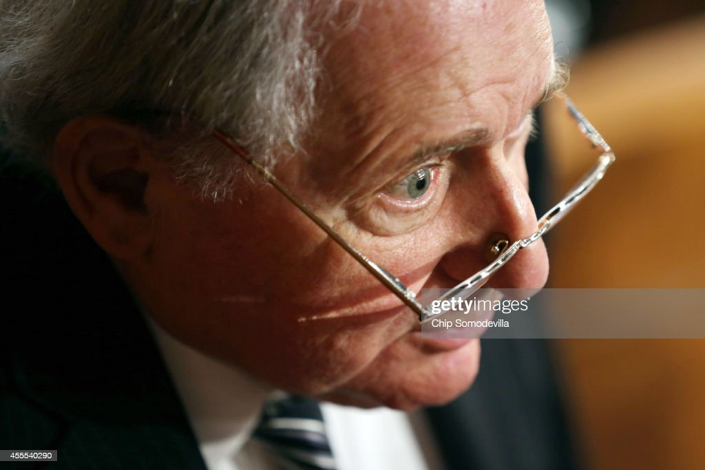 Senate Armed Services Committee Chairman <a gi-track='captionPersonalityLinkClicked' href=/galleries/search?phrase=Carl+Levin&family=editorial&specificpeople=208878 ng-click='$event.stopPropagation()'>Carl Levin</a> (D-MI) talks to reporters after a hearing in the Hart Senate Office Building on Capitol Hill September 16, 2014 in Washington, DC. Senators questioned the top military and civilian leaders about the threat posed by the terrorist group calling itself the Islamic State of Iraq and the Levant or ISIL.