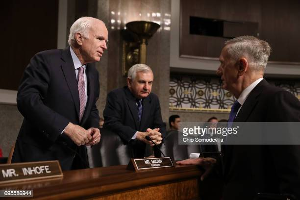 Senate Armed Services Committee Chairman John McCain and ranking member Sen Jack Reed visit with Secretary of Defense James Mattis before a hearing...