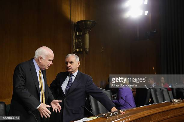 Senate Armed Services Committee Chairman John McCain talks with ranking member Sen Jack Reed before a hearing testimony from Gen Lloyd Austin III...