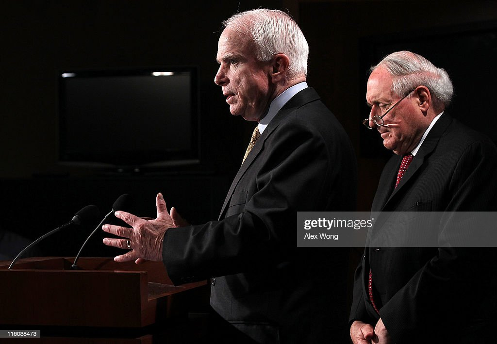 U.S. Senate Armed Services Committee Chairman Sen. <a gi-track='captionPersonalityLinkClicked' href=/galleries/search?phrase=Carl+Levin&family=editorial&specificpeople=208878 ng-click='$event.stopPropagation()'>Carl Levin</a> (D-MI) (R) and ranking member Sen. <a gi-track='captionPersonalityLinkClicked' href=/galleries/search?phrase=John+McCain&family=editorial&specificpeople=125177 ng-click='$event.stopPropagation()'>John McCain</a> (R-AZ) speak to the media during a news conference June 14, 2011 on Capitol Hill in Washington, DC. The senators held a news conference to discuss an ongoing Senate Armed Services Committee investigation into counterfeit electronic parts from China in the Defense Department's supply chain.