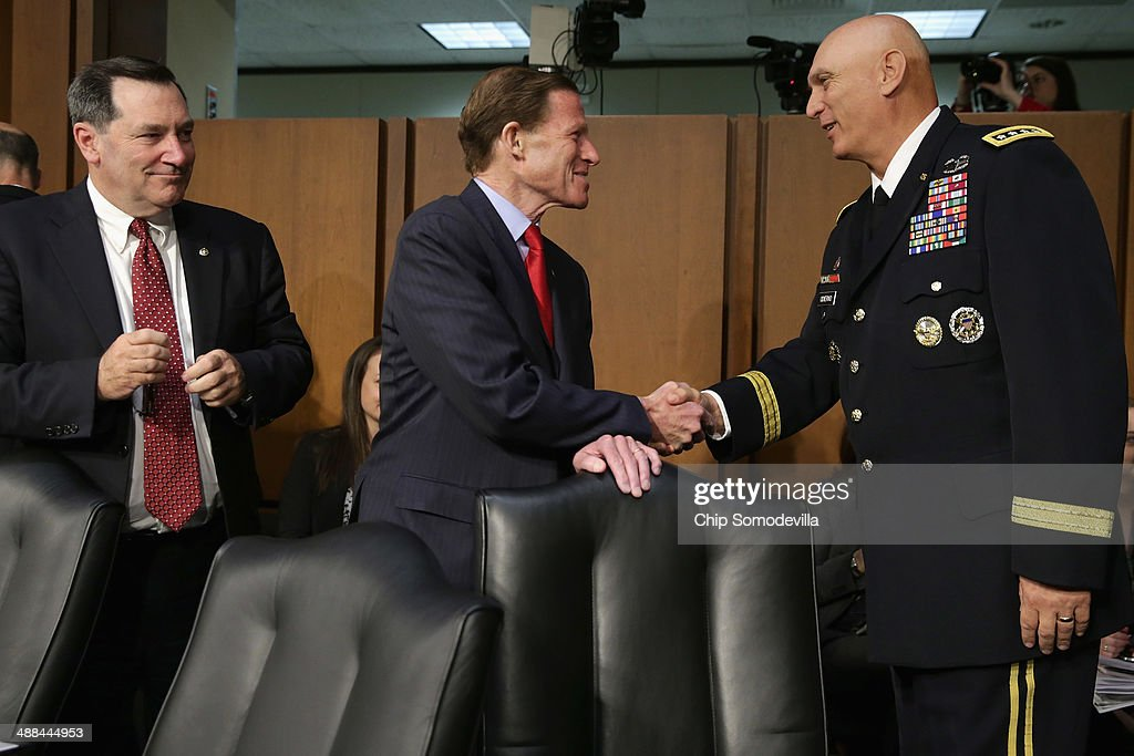 Senate Armed Services Committee members Sen. Joe Donnelly (D-IN) and Sen. Richard Blumenthal (D-CT) greet Chief of Staff of the Army Gen. Raymond Odierno before a committee with other members of the U.S. military Joint Chiefs of Staff on Capitol Hill May 6, 2014 in Washington, DC. Joined by senior enlisted officers, the Joint Chiefs testified about proposals relating to military compensation.