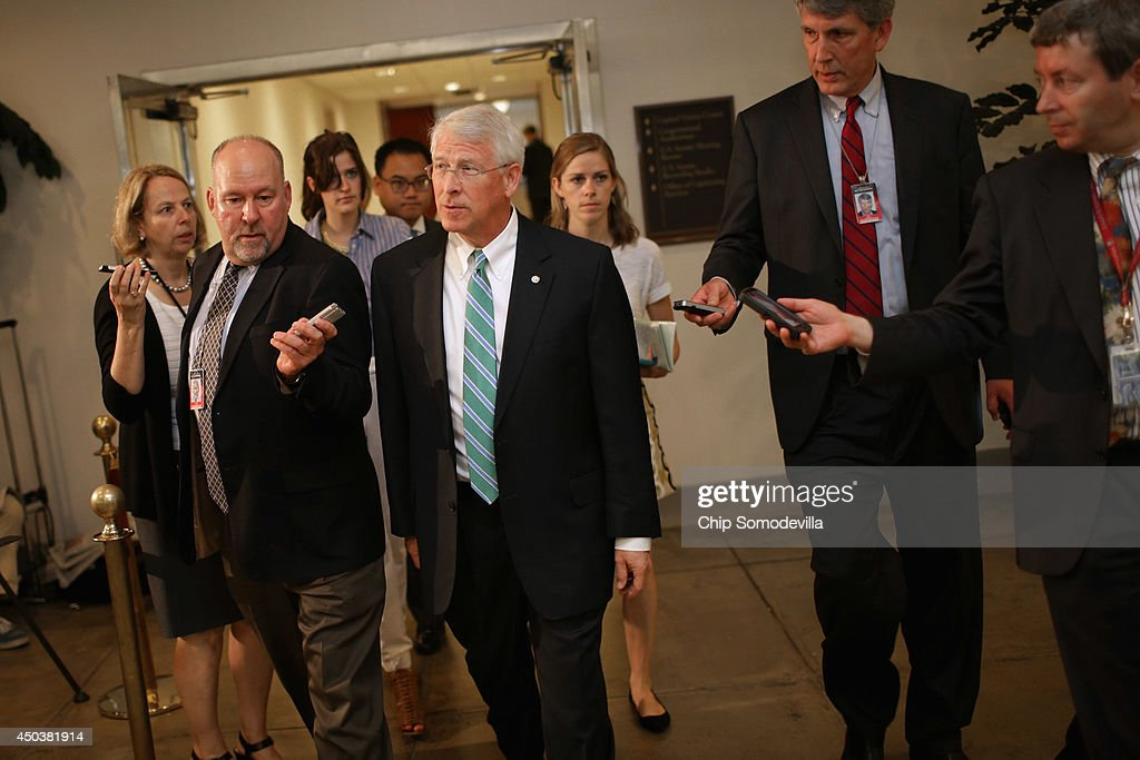 Senate Armed Services Committee U.S. Sen. <a gi-track='captionPersonalityLinkClicked' href=/galleries/search?phrase=Roger+Wicker&family=editorial&specificpeople=1194753 ng-click='$event.stopPropagation()'>Roger Wicker</a> (R-MS) is pursued by reporters after being briefed by military officals about the prisoner exchange that freed Army Sgt. Bowe Bergdahl at the U.S. Capitol June 10, 2014 in Washington, DC. The trade of Bergdahl for five senior Taliban officials has angered some members of Congress because they were not informed of the swap beforehand.