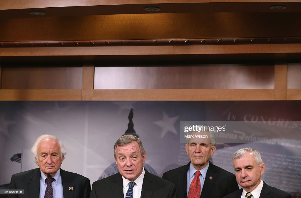 Senate Assistant Minority Leader <a gi-track='captionPersonalityLinkClicked' href=/galleries/search?phrase=Dick+Durbin&family=editorial&specificpeople=208219 ng-click='$event.stopPropagation()'>Dick Durbin</a>, (D-IL) (2ndL) speaks while flanked by House Ways and Means ranking member U.S. Rep. Sander Levin, (D-MI) (L), Senate Armed Services ranking member U.S. Sen. <a gi-track='captionPersonalityLinkClicked' href=/galleries/search?phrase=Jack+Reed+-+Homme+politique&family=editorial&specificpeople=534274 ng-click='$event.stopPropagation()'>Jack Reed</a>, (D-RI) (R) and U.S. Rep. Lloyd Doggett, (D-TX (2ndR)during a news conference on Capitol Hill, January 20, 2015 in Washington, DC. The Democratic lawmakers held the news conference to announce legislation to tighten restrictions on corporate tax inversions, making it more difficult for American companies to lower their U.S. taxation by combining with a smaller foreign business and moving their tax address overseas.