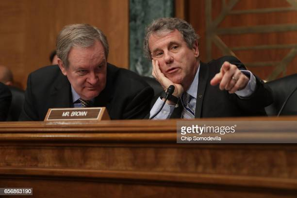 Senate Banking Committee Chairman Mike Crapo and ranking member Sen Sherrod Brown talk during the confirmation hearing for Jay Claton to be...