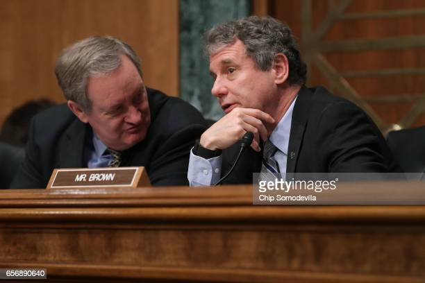 Senate Banking Committee Chairman Mike Crapo and ranking member Sen Sherrod Brown talks during the confirmation hearing for Jay Claton to be...