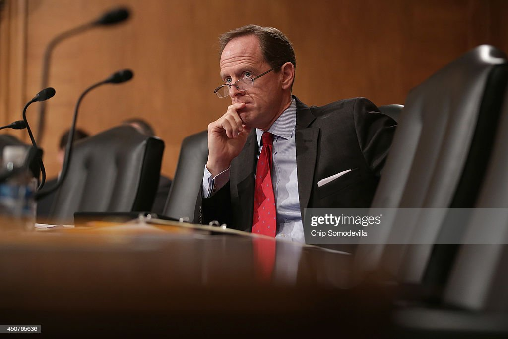 Senate Banking, Housing and Urban Affairs Committee member Sen. <a gi-track='captionPersonalityLinkClicked' href=/galleries/search?phrase=Pat+Toomey&family=editorial&specificpeople=3370648 ng-click='$event.stopPropagation()'>Pat Toomey</a> (R-PA) attends Mayor Julian Castro's confirmation hearing to be the next secretary of Housing and Urban Development in the Dirksen Senate Office Building on Capitol Hill June 17, 2014 in Washington, DC. The current mayor of San Antonio, Texas, Castro has not faced serious opposition in the Senate.