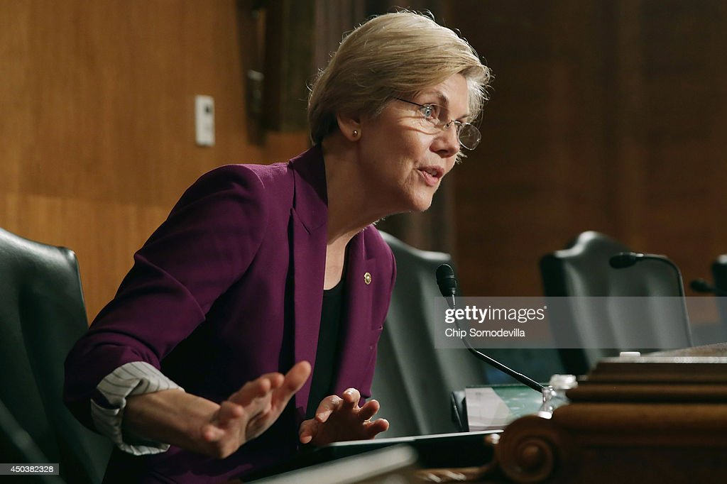 Senate Banking, Housing and Urban Affairs Committee member Sen. <a gi-track='captionPersonalityLinkClicked' href=/galleries/search?phrase=Elizabeth+Warren&family=editorial&specificpeople=5396017 ng-click='$event.stopPropagation()'>Elizabeth Warren</a> (D-MA) questions Consumer Financial Protection Bureau Director Richard Cordray in the Dirksen Senate Office Building on Capitol Hill June 10, 2014 in Washington, DC. Cordray was delivering the CFPB semi-annual report.