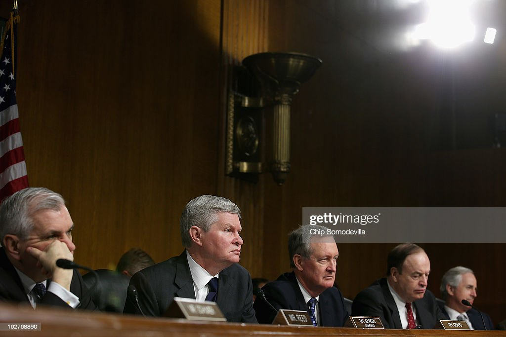 Senate Banking, Housing and Urban Affairs Committee members (L-R) Sen. <a gi-track='captionPersonalityLinkClicked' href=/galleries/search?phrase=Jack+Reed+-+Politician&family=editorial&specificpeople=534274 ng-click='$event.stopPropagation()'>Jack Reed</a> (D-RI), Chairman Tim Johnson (D-SD), Sen. Michael Crapo (R-ID), Sen. <a gi-track='captionPersonalityLinkClicked' href=/galleries/search?phrase=Richard+Shelby&family=editorial&specificpeople=529578 ng-click='$event.stopPropagation()'>Richard Shelby</a> (R-AL) and Sen. <a gi-track='captionPersonalityLinkClicked' href=/galleries/search?phrase=Bob+Corker&family=editorial&specificpeople=3986296 ng-click='$event.stopPropagation()'>Bob Corker</a> (R-TN) listen to testimony from Federal Reserve Bank Chairman Ben Bernanke after the release of The Semiannual Monetary Policy Report to the Congress February 26, 2013 in Washington, DC. Bernanke urged Congress to avoid the harsh sequestration cuts scheduled to begin March 1 with a plan to reduce federal deficits more gradually. He warned the sequestration could harm the economic recovery.