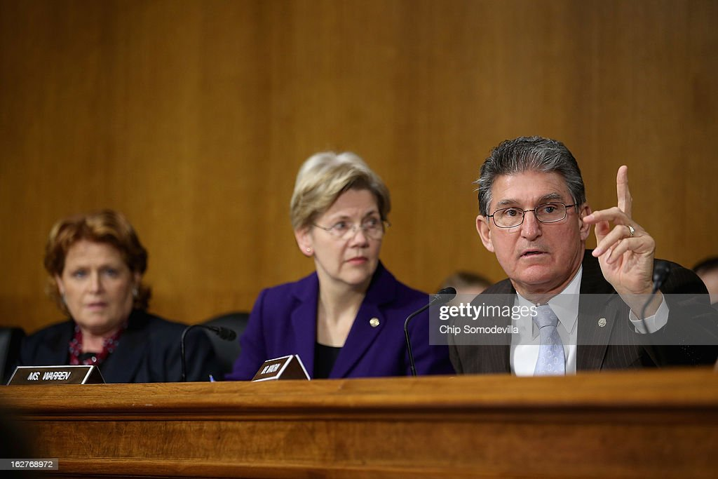 Senate Banking, Housing and Urban Affairs Committee members (R-L) Sen. <a gi-track='captionPersonalityLinkClicked' href=/galleries/search?phrase=Joe+Manchin&family=editorial&specificpeople=568465 ng-click='$event.stopPropagation()'>Joe Manchin</a> (D-WV), Sen. <a gi-track='captionPersonalityLinkClicked' href=/galleries/search?phrase=Elizabeth+Warren&family=editorial&specificpeople=5396017 ng-click='$event.stopPropagation()'>Elizabeth Warren</a> (D-MA) and Sen. Heidi Heitkamp (D-ND) participate in a hearing with Federal Reserve Bank Chairman Ben Bernanke after the release of The Semiannual Monetary Policy Report to the Congress February 26, 2013 in Washington, DC. Committee Chairman Tim Johnson (R-SD ) is at left. Bernanke urged Congress to avoid the harsh sequestration cuts scheduled to begin March 1 with a plan to reduce federal deficits more gradually. He warned the sequestration could harm the economic recovery.