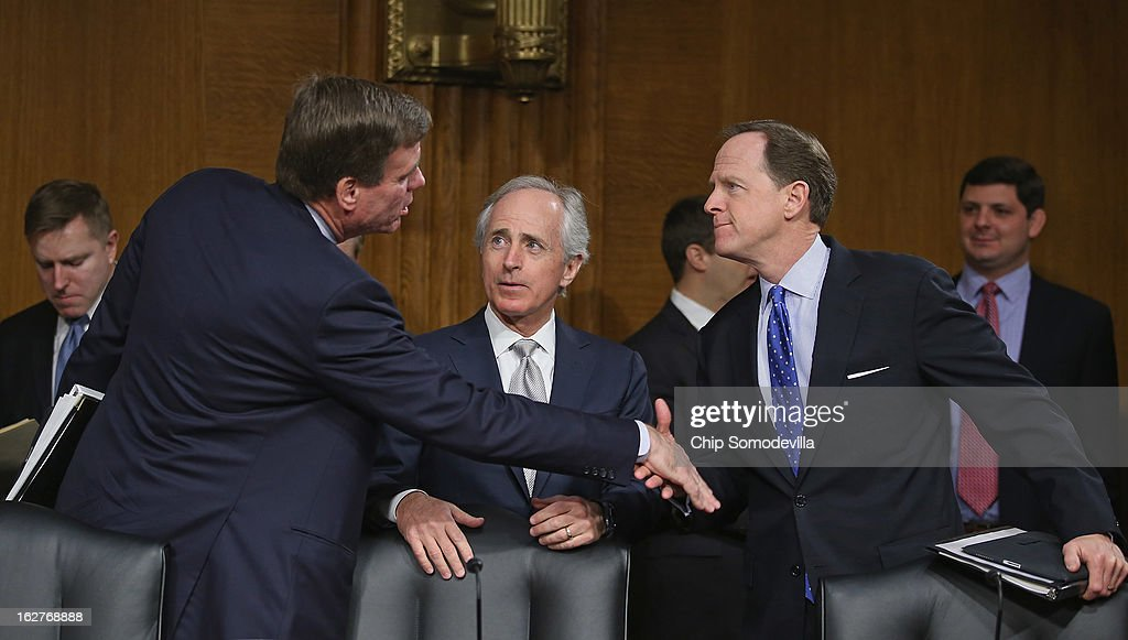 Senate Banking, Housing and Urban Affairs Committee members (L-R) Sen. <a gi-track='captionPersonalityLinkClicked' href=/galleries/search?phrase=Mark+Warner&family=editorial&specificpeople=2251151 ng-click='$event.stopPropagation()'>Mark Warner</a> (D-VA), Sen. <a gi-track='captionPersonalityLinkClicked' href=/galleries/search?phrase=Bob+Corker&family=editorial&specificpeople=3986296 ng-click='$event.stopPropagation()'>Bob Corker</a> (R-TN) and Sen. Pat Toomey (R-PA) greet one another before hearing testimony from Federal Reserve Bank Chairman Ben Bernanke after the release of The Semiannual Monetary Policy Report to the Congress February 26, 2013 in Washington, DC. Bernanke urged Congress to avoid the harsh sequestration cuts scheduled to begin March 1 with a plan to reduce federal deficits more gradually. He warned the sequestration could harm the economic recovery.