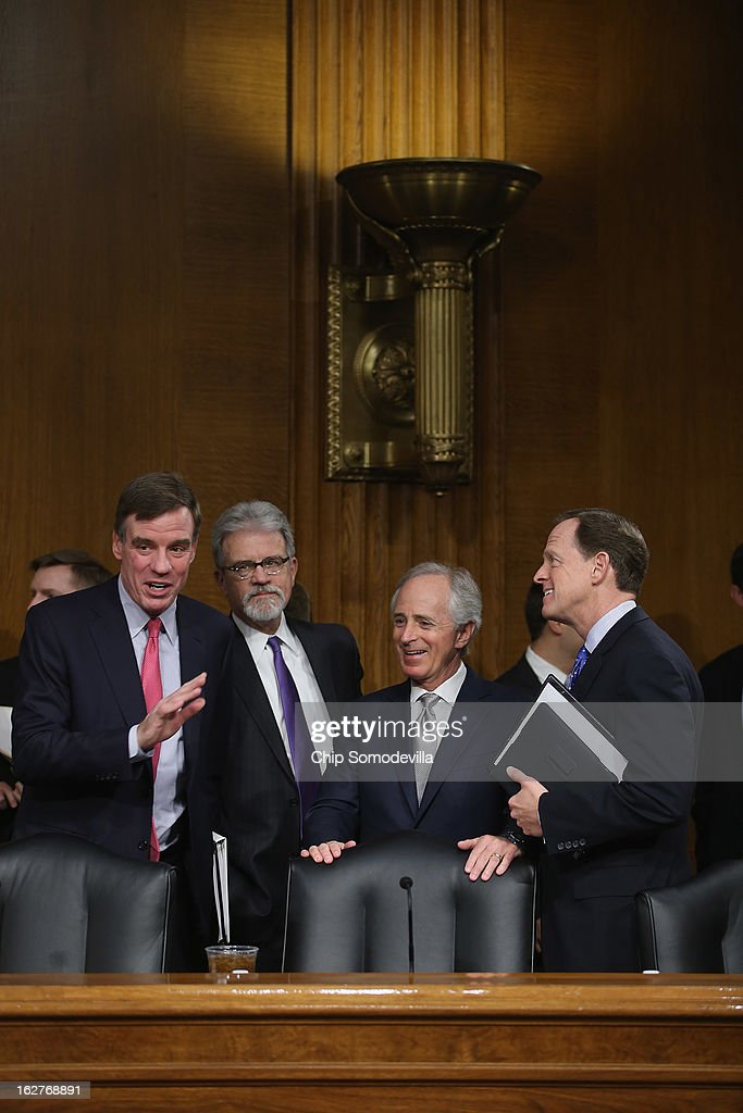 Senate Banking, Housing and Urban Affairs Committee members (L-R) Sen. <a gi-track='captionPersonalityLinkClicked' href=/galleries/search?phrase=Mark+Warner&family=editorial&specificpeople=2251151 ng-click='$event.stopPropagation()'>Mark Warner</a> (D-VA), Sen. <a gi-track='captionPersonalityLinkClicked' href=/galleries/search?phrase=Tom+Coburn&family=editorial&specificpeople=568690 ng-click='$event.stopPropagation()'>Tom Coburn</a> (R-OK), Sen. <a gi-track='captionPersonalityLinkClicked' href=/galleries/search?phrase=Bob+Corker&family=editorial&specificpeople=3986296 ng-click='$event.stopPropagation()'>Bob Corker</a> (R-TN) and Sen. Pat Toomey (R-PA) visit before hearing testimony from Federal Reserve Bank Chairman Ben Bernanke after the release of The Semiannual Monetary Policy Report to the Congress February 26, 2013 in Washington, DC. Bernanke urged Congress to avoid the harsh sequestration cuts scheduled to begin March 1 with a plan to reduce federal deficits more gradually. He warned the sequestration could harm the economic recovery.