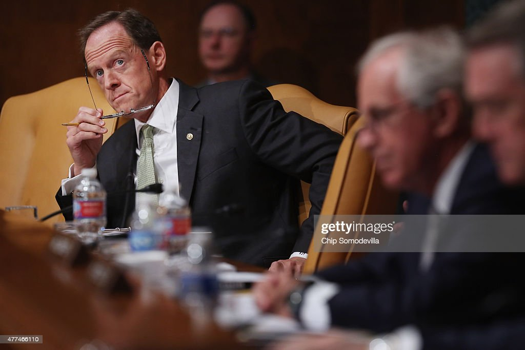 Senate Budget Committee member Sen. <a gi-track='captionPersonalityLinkClicked' href=/galleries/search?phrase=Pat+Toomey&family=editorial&specificpeople=3370648 ng-click='$event.stopPropagation()'>Pat Toomey</a> (R-PA) listens to testimony from Congressional Budget Office Director Keith Hall during a hearing in the Dirksen Senate Office Building on Capitol Hill June 17, 2015 in Washington, DC. Hall told the committee that federal debt would climb to over 100-percent of the total GDP by 2040 without major spending course correction.