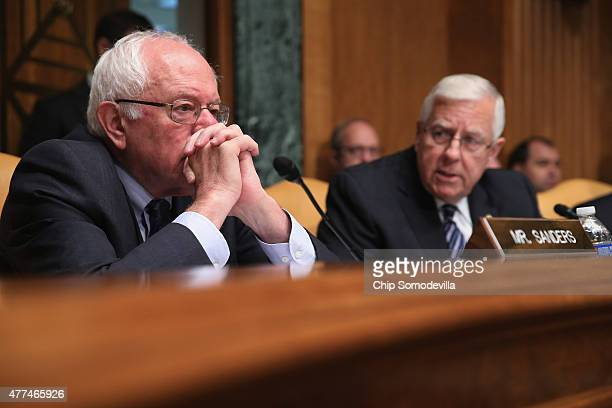 Senate Budget Committee ranking member and presidential candidate US Sen Bernie Sanders listens to opening remarks from Chairman Mike Enzi in the...