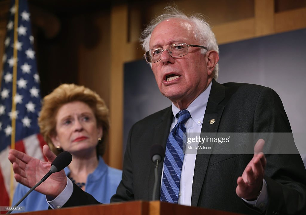 Senate Budget Committee ranking member <a gi-track='captionPersonalityLinkClicked' href=/galleries/search?phrase=Bernie+Sanders&family=editorial&specificpeople=2908340 ng-click='$event.stopPropagation()'>Bernie Sanders</a> (I-VT) speaks about ending sequestration while flanked by Sen. <a gi-track='captionPersonalityLinkClicked' href=/galleries/search?phrase=Debbie+Stabenow&family=editorial&specificpeople=221624 ng-click='$event.stopPropagation()'>Debbie Stabenow</a> (D-MI), during a news conference on Capitol Hill, March 11, 2015 in Washington, DC. Senate Budget Committee Democrats urged Congress to end sequestration to help build back the middle class, invest in job creation and fight for an increase in the minimum wage.