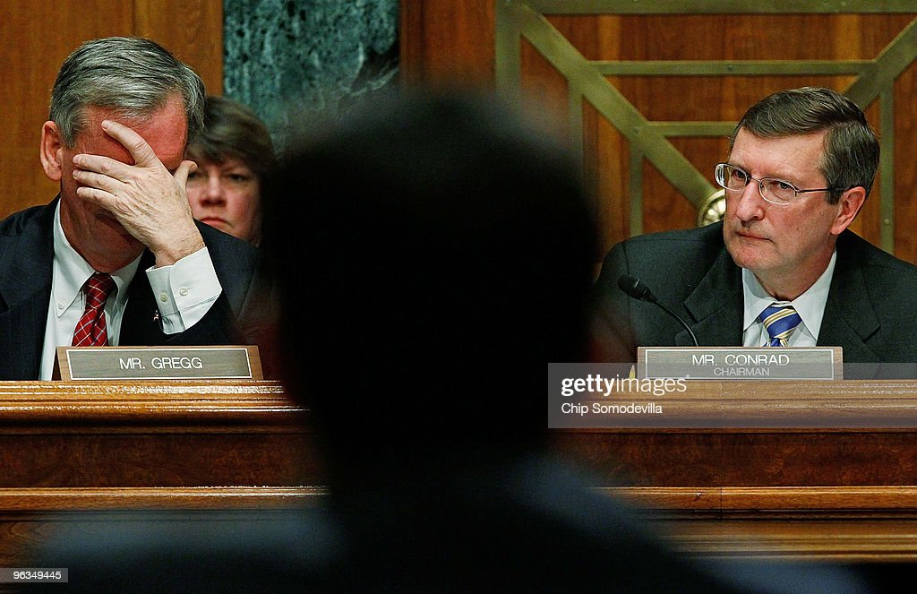 Senate Budget Committee ranking member Sen. <a gi-track='captionPersonalityLinkClicked' href=/galleries/search?phrase=Judd+Gregg&family=editorial&specificpeople=644815 ng-click='$event.stopPropagation()'>Judd Gregg</a> (R-NH) (L) and Chairman <a gi-track='captionPersonalityLinkClicked' href=/galleries/search?phrase=Kent+Conrad&family=editorial&specificpeople=654003 ng-click='$event.stopPropagation()'>Kent Conrad</a> (D-ND) listen to testimony from White House Office of Managment and Budget Director Peter Orszag about the Obama Administration's FY2011 budget on Capitol Hill February 2, 2010 in Washington, DC. Gregg accused Orszag and the administration of not following the law when it proposes using TARP funds as loans to small businesses instead of using the money to pay down the deficit.