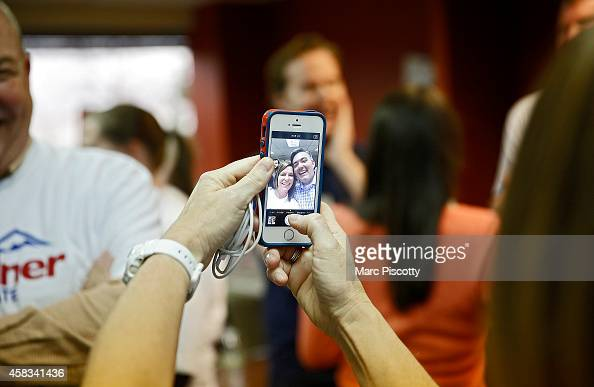 Senate candidate Corey Gardner poses for a selfie with volunteer Jen Larkin of Spring Lake New Jersey after a rally with supporters at a Republican...