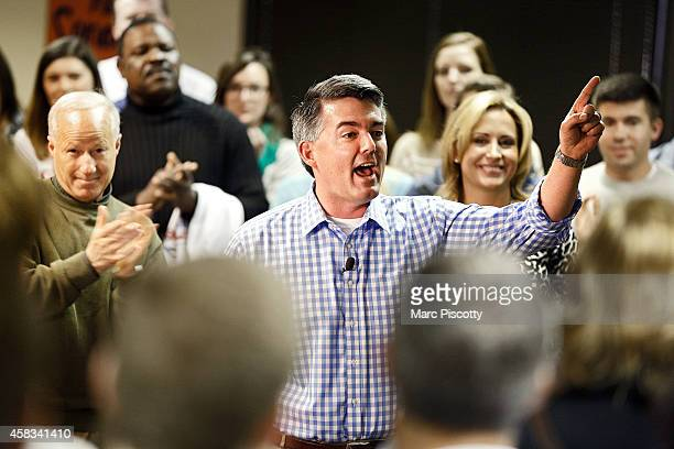 Senate candidate Corey Gardner rallies with supporters and speaks with the media at a Republican campaign office on November 3 2014 in Greenwood...