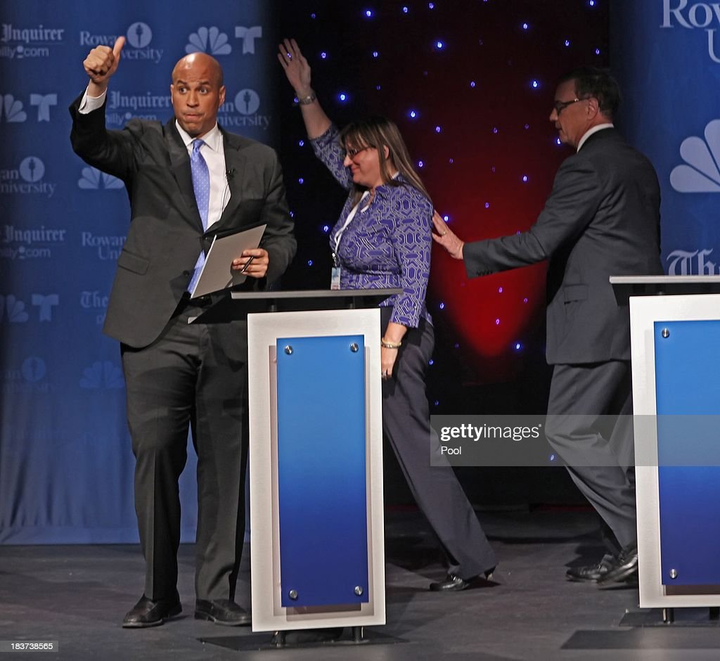 U.S. Senate candidate Cory Booker (L) gives a thumbs up at the end of the debate as Lorraine Rossi Lonegan (C) and her husband Republican Senate candidate Steve Lonegan (R) leave the stage after their second televised debate at Pfleeger Concert Hall, Wilson Hall, Rowan University, on October 9, 2013 in Glassboro, New Jersey. Voters go to the polls November 5.