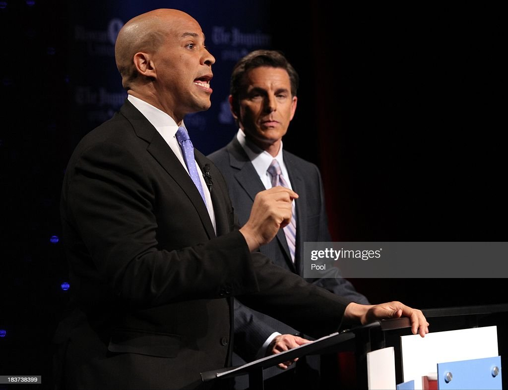 U.S. Senate candidate <a gi-track='captionPersonalityLinkClicked' href=/galleries/search?phrase=Cory+Booker&family=editorial&specificpeople=638070 ng-click='$event.stopPropagation()'>Cory Booker</a> (L) speaks during his second televised debate with Steve Lonegan (not pictured) at Pfleeger Concert Hall, Wilson Hall, Rowan University, on October 9, 2013 in Glassboro, New Jersey. Voters go to the polls November 5.