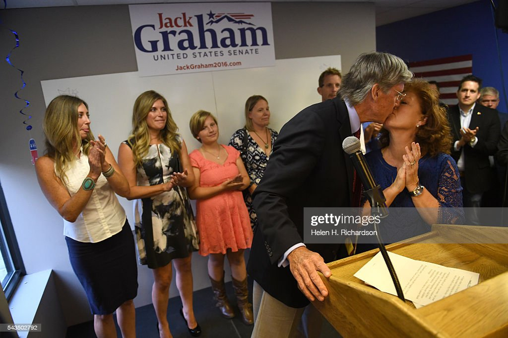 Senate candidate hopeful Jack Graham gives a kiss to his wife Ginger after giving his concession speech to members of his election team at their headquarters on June 29, 2016. Graham had hoped to win the primary to be able to take on Senator Michael Bennet but lost out to Darryl Glenn who won the Colorado Republican nomination for US Senate. His daughters Kaylee Graham, left, and Jamie Larson, second from left, and granddaughter Kendal Graham are in back.