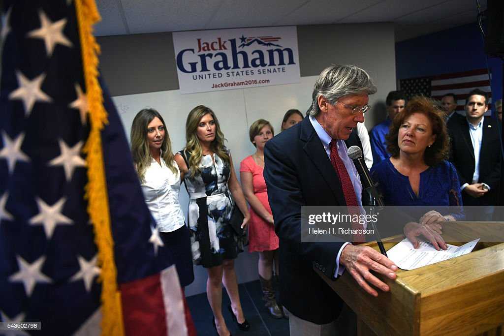 Senate candidate hopeful Jack Graham gives his concession speech, with his wife Ginger, right, by his side and his daughters Kaylee Graham and Jamie Larson, in back from left to right, to members of his election team at their headquarters on June 29, 2016. Graham had hoped to win the primary to be able to take on Senator Michael Bennet but lost out to Darryl Glenn who won the Colorado Republican nomination for US Senate.