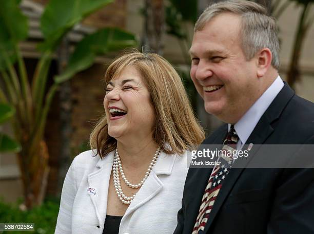 S Senate candidate Loretta Sanchez and her husband Jack Einwechter talk to the media after casting their votes at Orange High School on the morning...