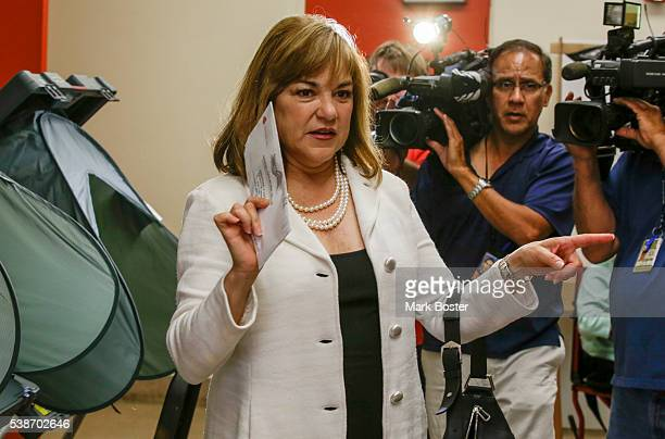 S Senate candidate Loretta Sanchez looks for a ballot box after casting her vote at Orange High School with her husband Jack Einwechter on the...
