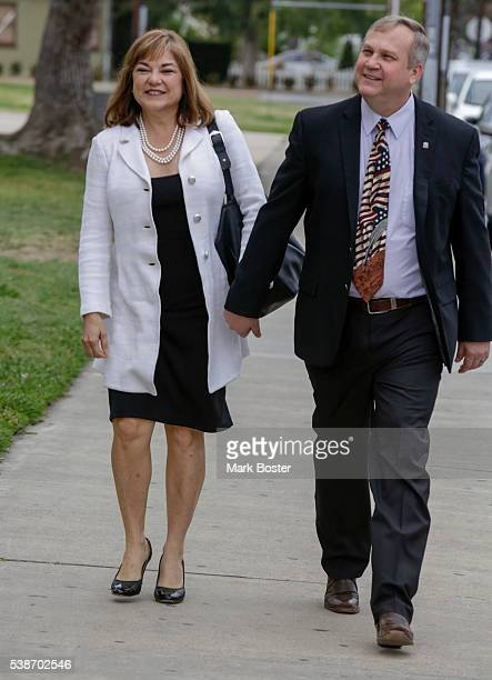 S Senate candidate Loretta Sanchez walks to the polling place to cast her vote at Orange High School with her husband Jack Einwechter on the morning...