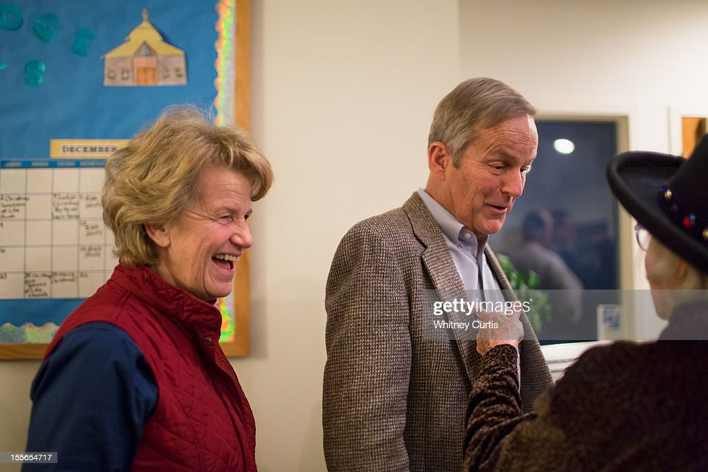 Senate candidate, Rep. Todd Akin (R-MO) and his wife, Lulli Akin speak to a voter as they wait in line to vote November 6, 2012 in Wildwood, Missouri. Akin, who made headlines with his controversial comments about abortion, is running against incumbent Sen. Claire McCaskill (D-MO).