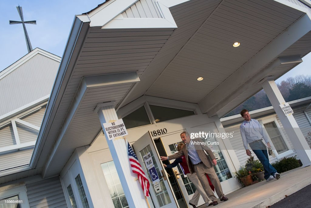 Senate candidate, Rep. Todd Akin (R-MO) (L), his wife, Lulli Akin, and son, Wynn Akin, leave their polling location after voting November 6, 2012 in Wildwood, Missouri. Akin is running against incumbent Sen. Claire McCaskill (D-MO).