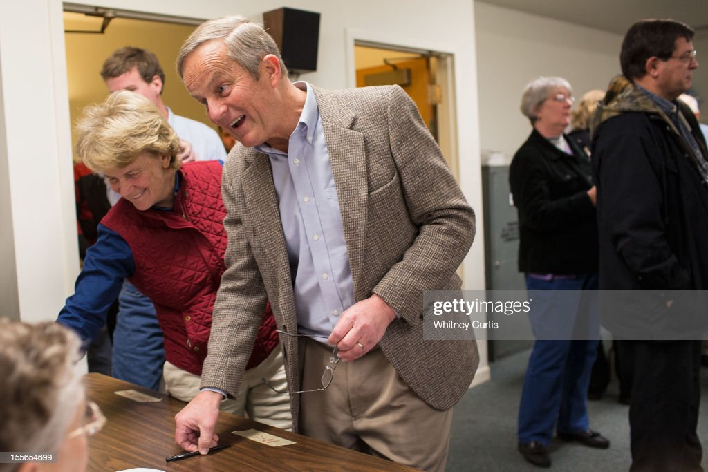 Senate candidate, Rep. Todd Akin (R-MO) (R-L), his wife, Lulli Akin, and son, Wynn Akin, speak to poll workers before casting their ballots November 6, 2012 in Wildwood, Missouri. Akin, who made headlines with his controversial comments about abortion, is running against incumbent Sen. Claire McCaskill (D-MO).