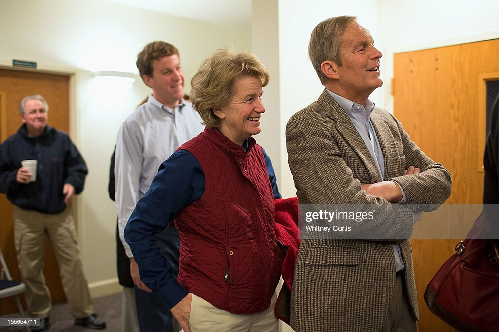 Senate candidate, Rep. Todd Akin (R-MO) (R-L), his wife, Lulli Akin, and son, Wynn Akin, wait in line to vote November 6, 2012 in Wildwood, Missouri. Akin, who made headlines with his controversial comments about abortion, is running against incumbent Sen. Claire McCaskill (D-MO).