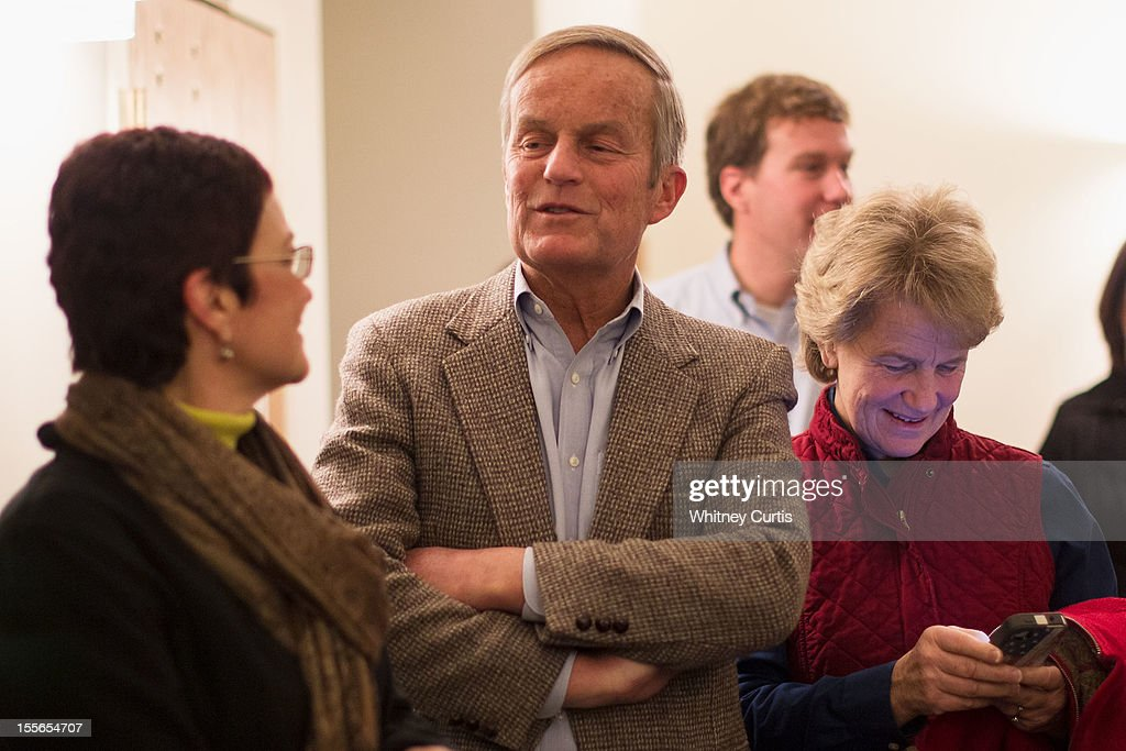 Senate candidate, Rep. Todd Akin (R-MO) (L-R), son, Wynn Akin, and his wife, Lulli Akin wait in line to vote November 6, 2012 in Wildwood, Missouri. Akin, who made headlines with his controversial comments about abortion, is running against incumbent Sen. Claire McCaskill (D-MO).