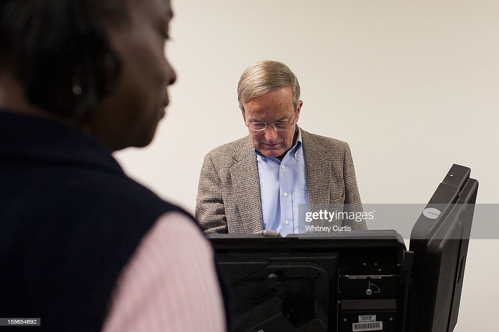 Senate candidate, Rep. Todd Akin (R-MO) votes electronically as a poll worker looks on November 6, 2012 in Wildwood, Missouri. Akin, who made headlines with his controversial comments about abortion, is running against incumbent Sen. Claire McCaskill (D-MO).