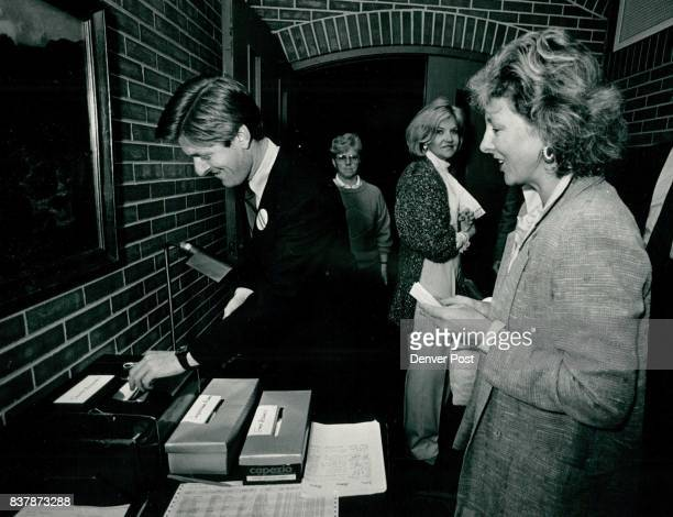Senate Candidate Terry Considine voting at the home of the Cooks with Judy Fitzgerald waiting her turn to drop her ballots in the three boxes Credit...