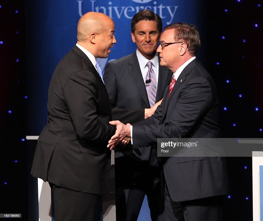U.S. Senate candidates <a gi-track='captionPersonalityLinkClicked' href=/galleries/search?phrase=Cory+Booker&family=editorial&specificpeople=638070 ng-click='$event.stopPropagation()'>Cory Booker</a> (L) and Steve Lonegan (R) shake hands after their second televised debate moderatred by Tim Rosenfield (C), NBC 10, at Pfleeger Concert Hall, Wilson Hall, Rowan University, on October 9, 2013 in Glassboro, New Jersey. Voters go to the polls November 5.