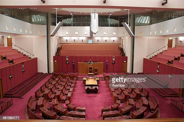 Senate Chamber in Parliament House with its red colour scheme matching that of the House of Lords of the British parliament the presiding officer of...