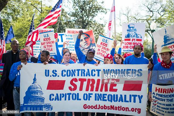 Senate contract employees along with hundreds of workers from the US Capitol Pentagon Smithsonian Institution and other federal landmarks march to...