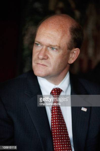 S Senate Democratic candidate Chris Coons listens to a group of business owners during a lunch meeting at the Domaine Hudson Wine Bar and Eatery...