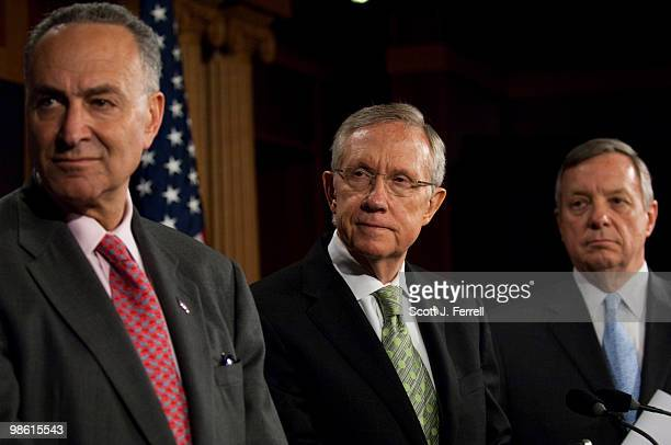 Senate Democratic Caucus Vice Chairman Charles E Schumer DNY Senate Majority Leader Harry Reid DNev and Senate Assistant Majority Leader Richard J...