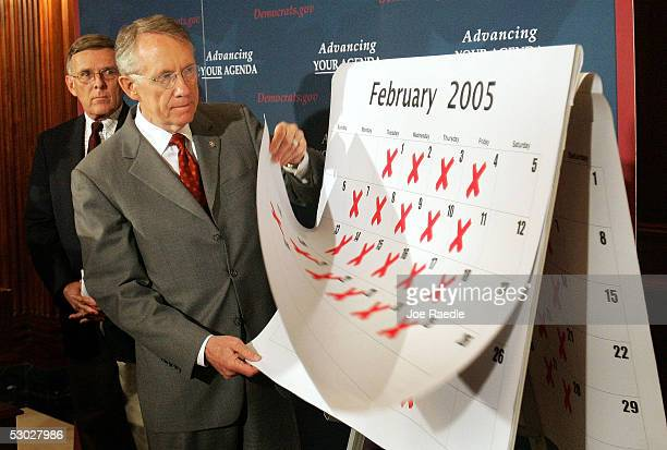 S Senate Democratic leader Harry Reid and Senator Byron Dorgan show off a calendar during a press conference that they say show the days since the...