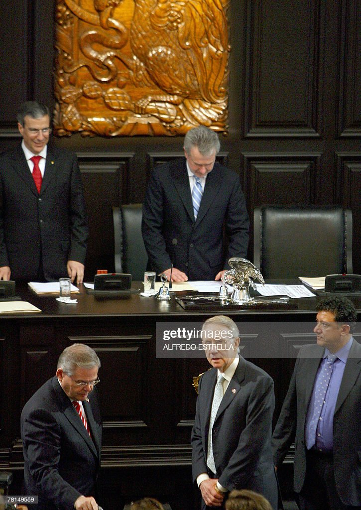 US Senate Democratic Majority leader Harry Reid and US senator Byron Dorgan are escorted by a bodyguard during a reception ceremony at the Mexican...