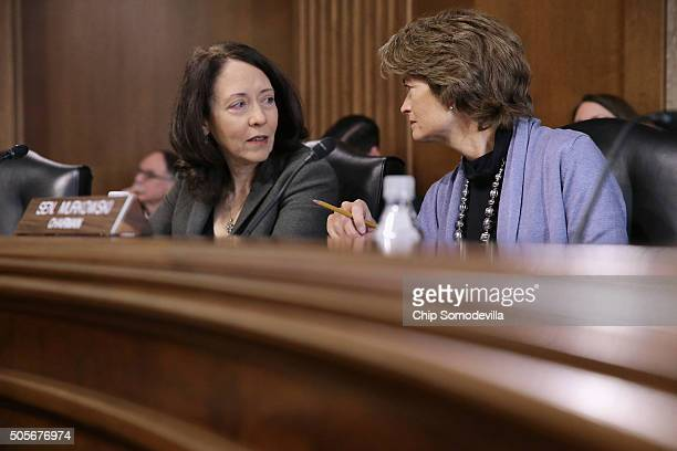 S Senate Energy and Natural Resources Committee Chair Lisa Murkowski and ranking member Sen Maria Cantwell confer during a hearing about the outlook...