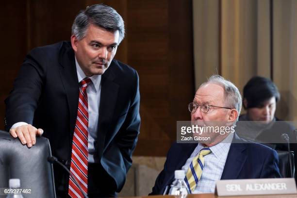 Senate Energy Subcommittee Chairman Sen Cory Gardner left speaks to Sen Lamar Alexander a Republican from Tennessee left before a Senate Energy...