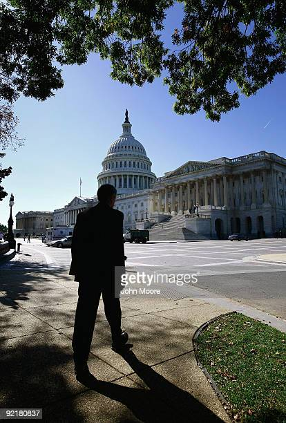 Senate Finance Chairman Max Baucus walks from his office to the Capitol October 21 2009 in Washington DC Baucus' Finance Committee passed health care...
