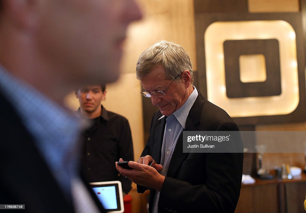 Senate Finance Committee Chairman <a gi-track='captionPersonalityLinkClicked' href=/galleries/search?phrase=Max+Baucus&family=editorial&specificpeople=242972 ng-click='$event.stopPropagation()'>Max Baucus</a> (D-MT) attempts to download the Square Wallet app while touring the Square headquarters on August 19, 2013 in San Francisco, California. Senators <a gi-track='captionPersonalityLinkClicked' href=/galleries/search?phrase=Max+Baucus&family=editorial&specificpeople=242972 ng-click='$event.stopPropagation()'>Max Baucus</a> (D-MT) and Dave Camp (R-MI) continued their Tax Reform Tour with a visit to the headquarters of mobile payment company Square. The tour is taking the two senators across the nation to speak to American people about how to fix the nation's broken tax code to benefit families and job creators.