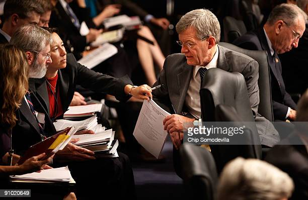 Senate Finance Committee Chairman Max Baucus is handed some papers from committee staff while presiding over a mark up session on the health care...